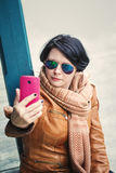 Middle aged caucasian brunette woman outside autumn in sunglasse Stock Photo