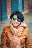 Middle aged caucasian brunette woman outside autumn in sunglasse Royalty Free Stock Photo