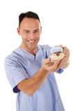 Middle aged caucasian male dentist Stock Images