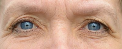 Middle aged caucasian woman eyes in close-up stock photo