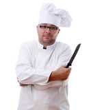 Middle-aged chef holding a kitchen knife Royalty Free Stock Photo