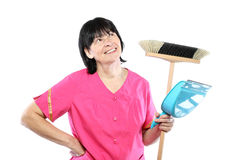 Middle aged cleaning lady with broom and scoop Royalty Free Stock Image