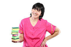 Middle aged cleaning lady with sponges Royalty Free Stock Images