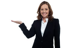 Middle aged corporate woman showing copy space Stock Photo