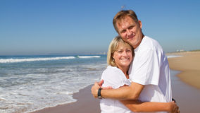 Middle aged couple. Happy middle aged couple embracing on beach Royalty Free Stock Image
