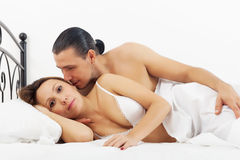 Middle-aged couple awaking in bed Royalty Free Stock Image