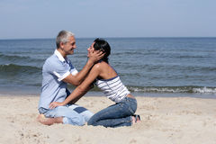 Middle-aged couple on the beach Royalty Free Stock Images