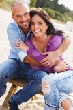Middle-aged couple on a beach Stock Image