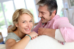 Middle-aged couple being happy at home royalty free stock image