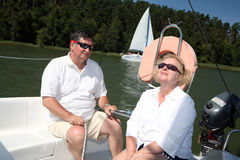 Middle-aged couple on boat sailing Royalty Free Stock Photo