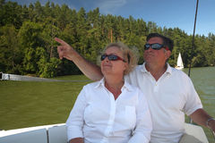 Middle-aged couple on boat sailing Royalty Free Stock Images