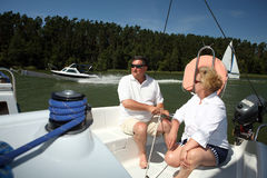Middle-aged couple on boat sailing Stock Photos