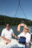 Middle-aged couple on boat sailing Royalty Free Stock Image