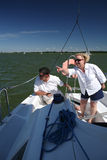 Middle-aged couple on boat sailing Stock Images