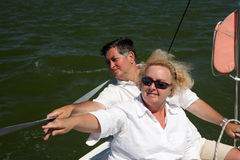 Middle-aged couple on boat sailing royalty free stock photography