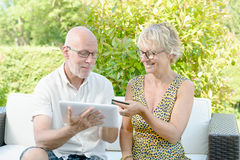 A middle-aged couple buys online Royalty Free Stock Photo