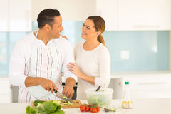 Middle aged couple cooking. Romantic middle aged couple in kitchen cooking food Stock Images