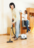 Middle-aged couple doing housework together Stock Photography