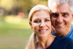 Middle aged couple. Elegant middle aged couple closeup portrait outdoors Royalty Free Stock Photography