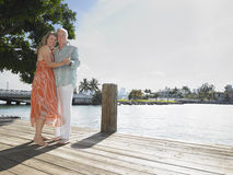 Middle Aged Couple Embracing On Pier Royalty Free Stock Photography