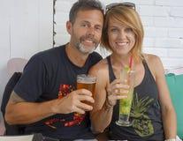 Middle-aged couple enjoying drinks Royalty Free Stock Image