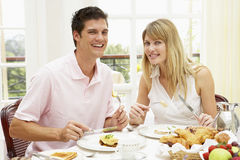 Middle Aged Couple Enjoying Hotel Breakfast Royalty Free Stock Photography