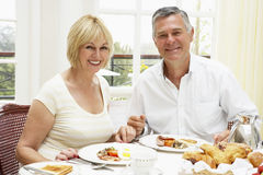 Middle Aged Couple Enjoying Hotel Breakfast Stock Image