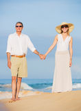Middle Aged Couple Enjoying Walk on the Beach Stock Photo
