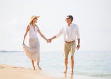 Middle Aged Couple Enjoying Walk on the Beach Stock Image