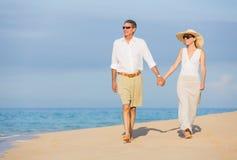 Middle Aged Couple Enjoying Walk on the Beach Stock Photography