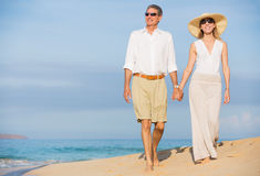 Middle Aged Couple Enjoying Walk on the Beach Royalty Free Stock Image