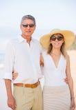 Middle Aged Couple Enjoying Walk on the Beach Stock Photos