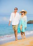 Middle Aged Couple Enjoying Walk on the Beach Royalty Free Stock Photo