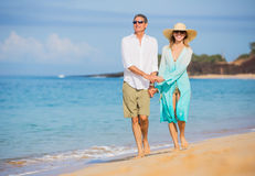 Middle Aged Couple Enjoying Walk on the Beach Stock Photography