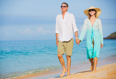 Middle Aged Couple Enjoying Walk on the Beach Stock Image