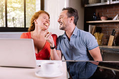 Middle aged couple frolicking in kitchen Stock Photos