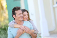 Middle-aged couple in front of the house Royalty Free Stock Image