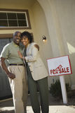 Middle-aged couple in front of new home Royalty Free Stock Photo
