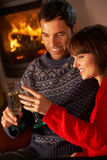 Middle Aged Couple  With Glass Of Champagne Stock Images