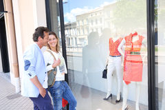 Middle-aged couple hanging out in front of clothing shops Stock Photos