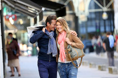 Middle-aged couple hanging out in the streets shopping Stock Photography