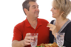 Middle aged couple having appetizers. Isolated on white Stock Photo