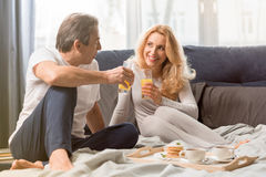 Middle aged couple having breakfast together in bed Stock Photo