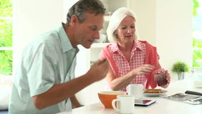 Middle Aged Couple Having Breakfast Together In Kitchen stock video