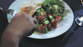 A MIDDLE-AGED COUPLE HAVING DINNER stock video
