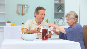 Middle aged couple having a lunch Royalty Free Stock Image