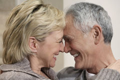 Middle Aged Couple With Heads Together Royalty Free Stock Photo