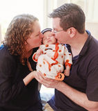 Middle aged couple holding newborn