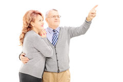 Middle aged couple in hug looking Stock Photography