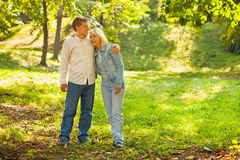 Middle aged couple hugging. In the park Royalty Free Stock Image